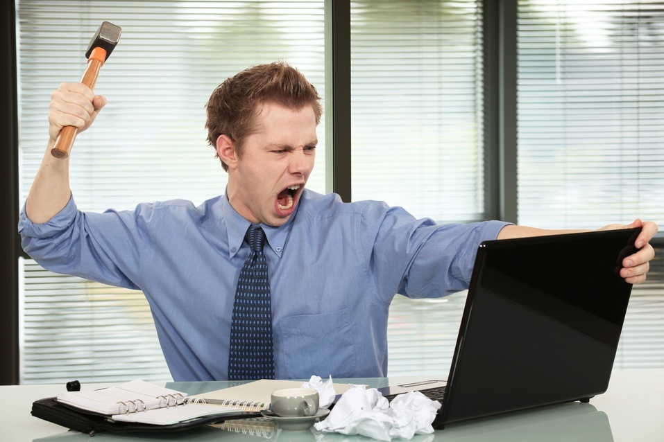 businessman frustrated angry with computer laptop