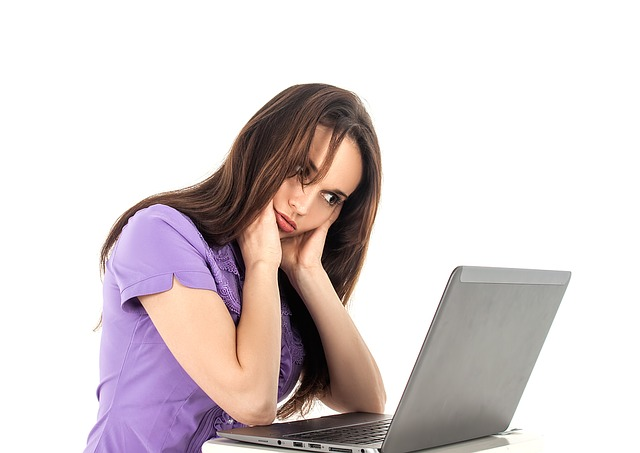 Female with laptop computer having IT issues