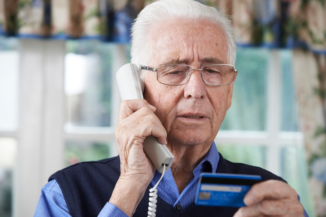 Elderly_man_falling_victim_to_telephone_scam.jpg